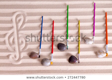 Music Staff Drawn in Sand with Paintbrush Notes Stock photo © ozgur
