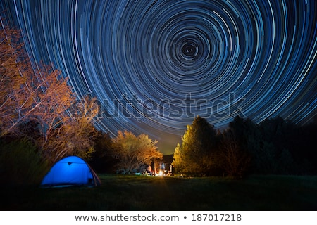 tent against the night sky with tracks from stars stock photo © all32