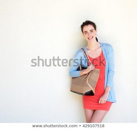 Aantrekkelijk jonge dame witte muur Stockfoto © feedough