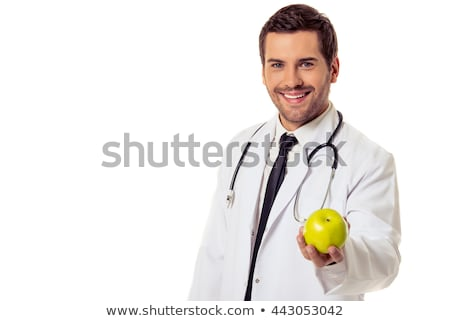portrait of a handsome male doctor holding apple stock photo © deandrobot
