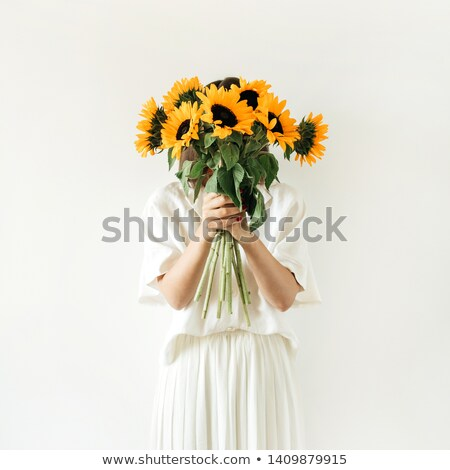 Stock photo: Woman in white dress holding flowers