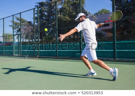 Tennis player hitting the ball Stock photo © fotoedu