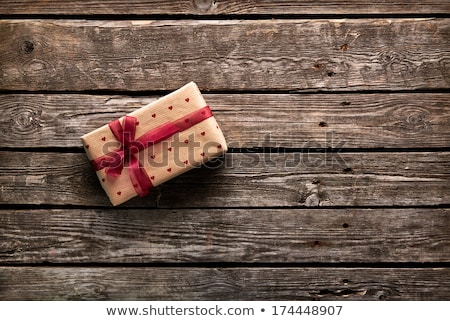 Small gift boxes tied with bows in a heart shape Stock photo © ozgur