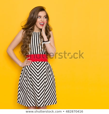 Beautiful woman posing in black dress with hands on hips Stock photo © deandrobot