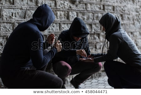 close up of addicts using drug pills Stock photo © dolgachov