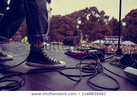 rocker with guitar and foot stock photo © leedsn
