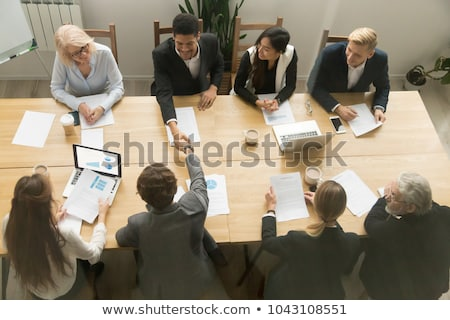 Hand of young businesswoman signing business contract agreement Stock photo © stevanovicigor