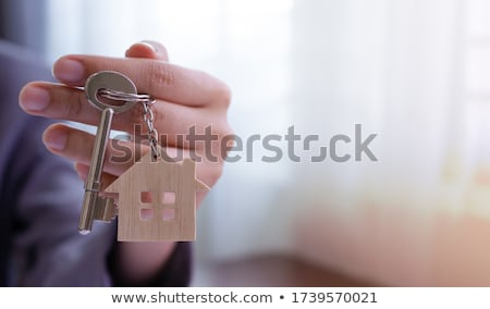 Real estate broker or agent offering house shaped key ring Stock photo © stevanovicigor