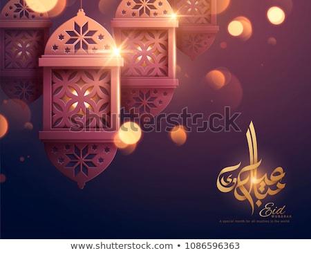 eid mubarak greeting card with golden sparkle background Stock photo © SArts