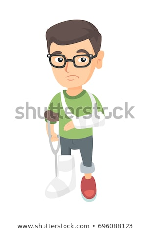 Caucasian sad injured boy with broken arm and leg. Stock photo © RAStudio