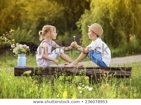 Portrait of two boys and a girl on bench Stock photo © IS2