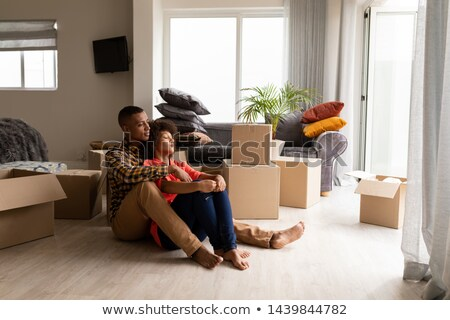 a couple surrounded by cardboard boxes stock photo © is2