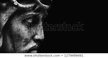face of jesus christ on a tomb stock photo © taigi