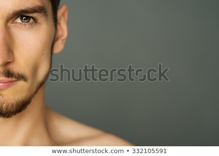 close up portrait of smiling half mens face stock photo © deandrobot