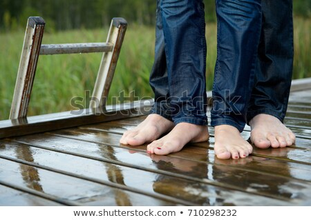 wet feet of a couple on a dock stock photo © is2