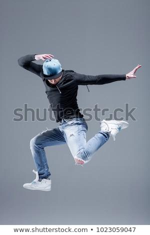 jovem · masculino · dançarina · posando · cinza · mão - foto stock © hannamonika