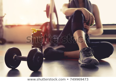 sportive woman with dumbbells Stock photo © studiostoks