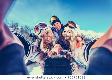 Four friends on skis Stock photo © IS2