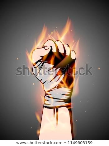MMA or boxing burning bandage fist uplifted hand. Mixed martial arts fighting flame emblem or logo Stock photo © Iaroslava