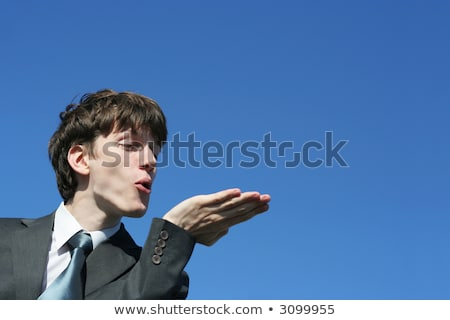 Businessman with kisses on his face in an empty space Stock photo © ra2studio