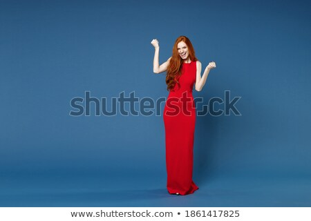 full length portrait of successful happy woman 20s wearing dress stock photo © deandrobot