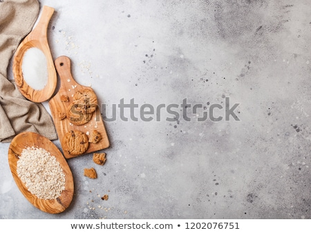 Healthy organic oat cookies with chocolate on wooden board on stone kitchen table background. Sugar  Stock photo © DenisMArt