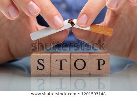 Woman Breaking Cigarette Over Stop Wooden Blocks Stock photo © AndreyPopov