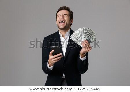 Kép érzelmes üzletember 30-as évek öltöny tart Stock fotó © deandrobot