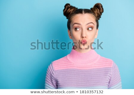 Image of lovely brunette woman with two buns blowing air kiss to Stock photo © deandrobot