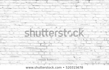 Stock photo: Cracked brick wall