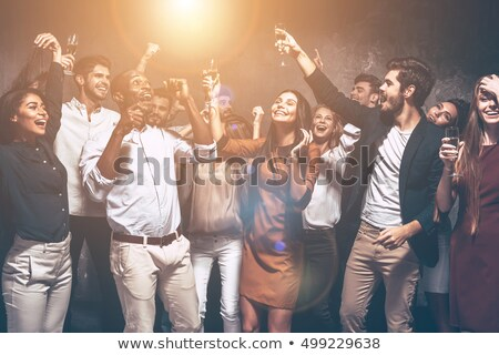 Group of happy young smartly dressed friends Stock photo © deandrobot