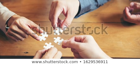 Hands Holding Jigsaw Puzzle Stock photo © AndreyPopov