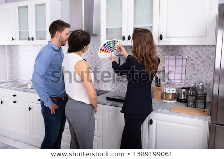 Real Estate Designer Showing Swatch Palette To Couple stock photo © AndreyPopov