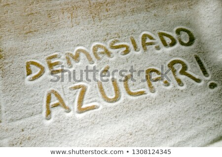 word sugar in spanish written with sugar stock photo © nito