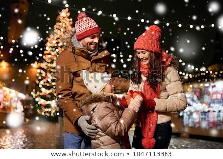 happy woman over christmas tree in tallinn Stock photo © dolgachov