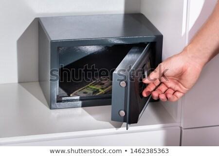 Kéz bankjegy öltözőszekrény széf előleg doboz Stock fotó © AndreyPopov