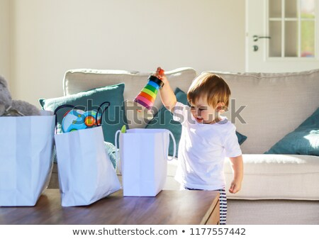 Cute little boy unpacking bag with toys Stock photo © nyul