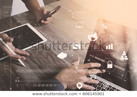 hand working on tablet with cryptocurrency concept stock photo © ra2studio
