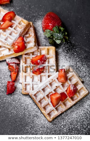 Belgium waffers and strawberries on black board background.  Stock photo © marylooo