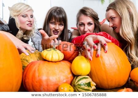 three women witches joining their malicious forces at halloween stock photo © kzenon