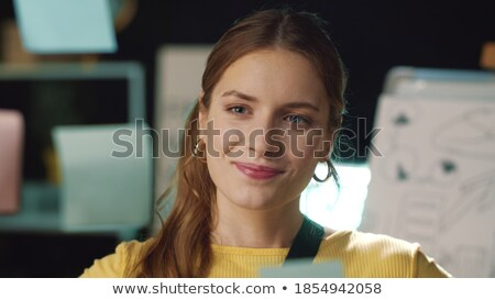 Young Entrepreneur woman manager working indoors at a modern off Stock photo © Freedomz