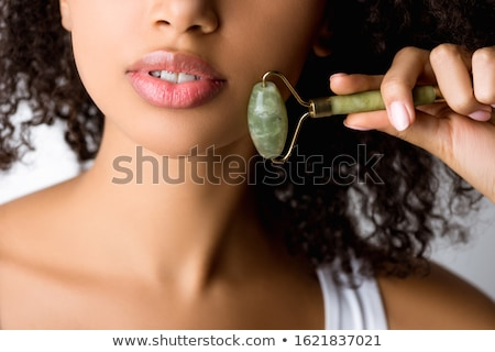Young Woman Using Jade Roller Stock photo © AndreyPopov