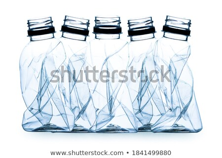 shadow from crushed plastic bottle with blue top stock photo © artjazz