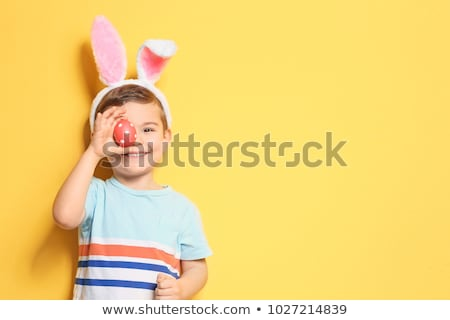 Little boy with Easter bunny stock photo © nyul