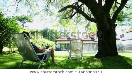 Senior uomo rilassante giardino home persona Foto d'archivio © HighwayStarz