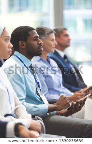 Side view of African american businessman attending a business seminar in office building Stock photo © wavebreak_media