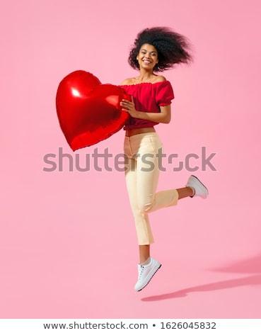 Afroamerikai nő léggömb valentin nap emberek boldog Stock fotó © dolgachov