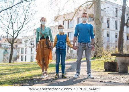 Family having a walk in the sun during coronavirus emergency Stock photo © Kzenon