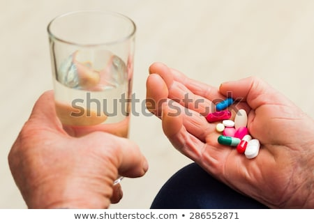 Health issues at an old age, taking several medicines. Stock photo © Lopolo