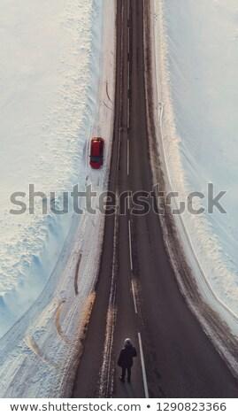 Surreal Bild ungewöhnliche Perspektive Frau Winter Stock foto © olira